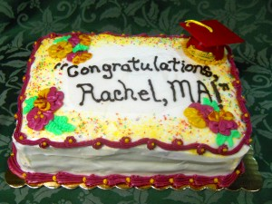 Graduation cake with a little hat, flowers, lettering