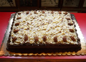 Classic German Chocolate cake prettily displayed before cutting