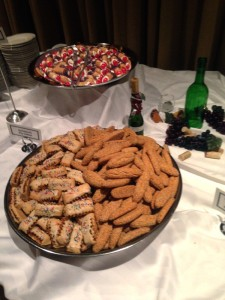 cannoli cuccidate and sesame biscotti on the sweets table