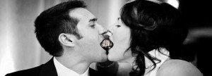 Bride and groom share a sweet morsel on their special day