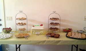 Full table of Italian Sweets - eclairs, cannoli, cookies, mints, cake - the works!