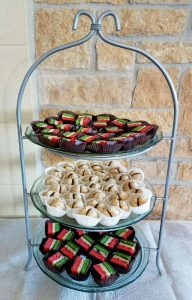 Three-tiered cookie tray has rainbow cookies and Lady Kisses - both with chocolate