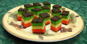 Cake-like layers in red white green like the Italian flag - topped with chocolate