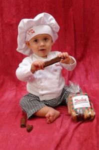 Silus in a chef's cap with chocolate biscotti.