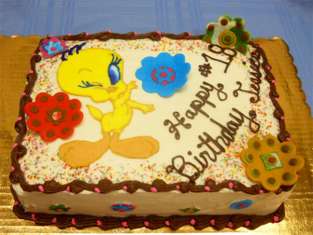 2012 birthday cake with flowers and Tweety winking