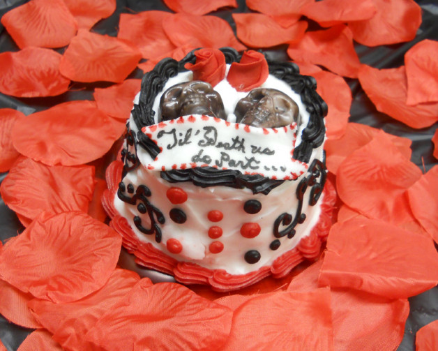 small cake with skulls prettily decorated